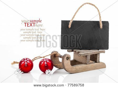 Black Board Of Slate On Old Rustic Wooden Sledge, Isolated Over White Background