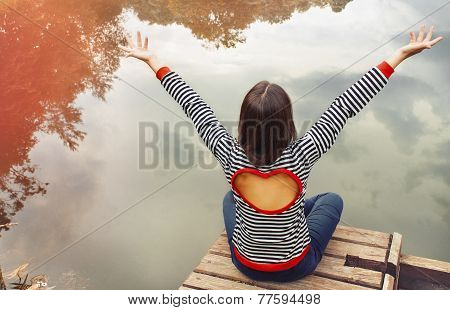 Cute Attractive Young Woman Enjoying Harmony Of Nature Near The Lake