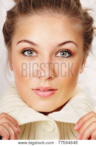 Portrait Of Affectionate Beautiful Young Woman In Knitted Jacket