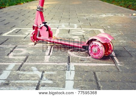 Background Of Playground With Pink Little Kid Scooter And Hopscotch
