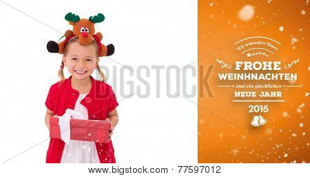 Cute little girl wearing rudolph headband against orange vignette