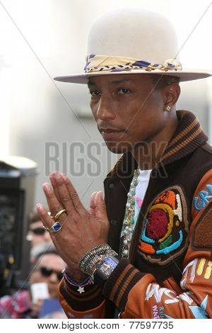LOS ANGELES - DEC 4:  Pharrell Williams at the Pharrell Williams Hollywood Walk of Fame Star Ceremony at the W Hotel Hollywood on December 4, 2014 in Los Angeles, CA
