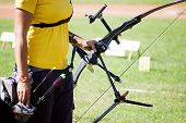 foto of shoot out  - Aarcher prepares the arc fir to shoot  - JPG