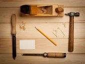 stock photo of wood craft  - joinery tools on wood table background with business card and copy space - JPG