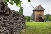 picture of fidget  - Wooden mill and braided fence in the countryside Poland - JPG