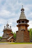 stock photo of ascension  - Old wooden Ascension Church and belfry in the reserve Malye Korely - JPG