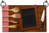 picture of ladle  - Advertising dark wooden sign for a restaurant with four wooden kitchen utensils fork spoons ladles on red and white checkered tablecloth empty blackboard and kitchen knife - JPG