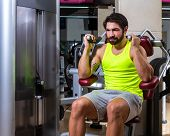 picture of crunch  - Abdominal crunch machine workout man sit at gym - JPG