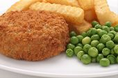 picture of potato chips  - Fishcake made with crumbed fish and potato served with chips and peas - JPG