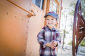 foto of caboose  - Cute Young Mixed Race Boy Having Fun Outside on Railroad Car - JPG