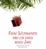 stock photo of weihnachten  - Frohe weihnachten message against red christmas decoration hanging from branch - JPG