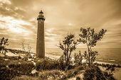 image of mear  - The Little Sable Point Lighthouse has been guiding mariners through the treacherous waters of the Great Lakes for over a century - JPG