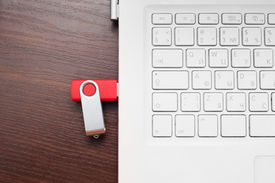 stock photo of backspace  - Flash memory drive plugged into a laptop port - JPG