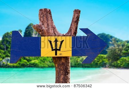 Barbados Flag wooden sign with beach background