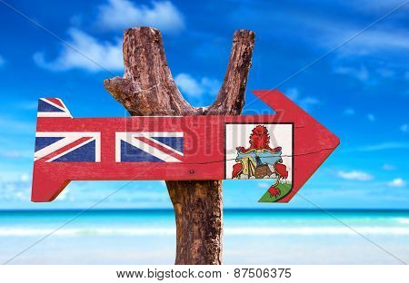 Bermuda Flag wooden sign with beach background