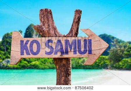 Ko Samui wooden sign with beach background