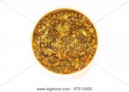 red lentil with outer skin gravy kept in a cup on plain background