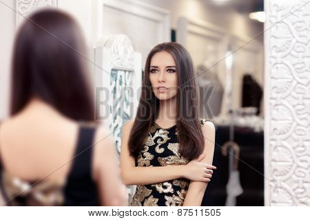 Beautiful Girl Looking in the Mirror and Trying on an Elegant Dress