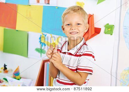 Schoolboy with a paper crane