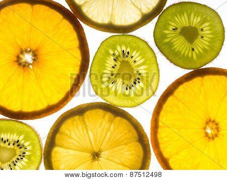 Several slices of lemon, orange and kiwifruit