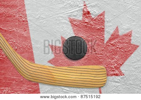 Hockey Puck, Hockey Stick And Canadian Flag