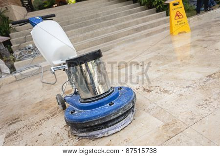 Close Up Blue Polishing Machine On The Floor