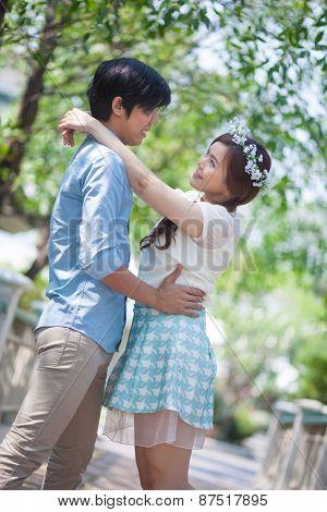 Loving Asian Couple Under Tree