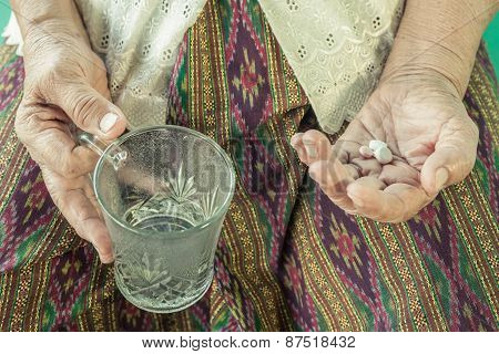Senior Asian Woman  With Medicine