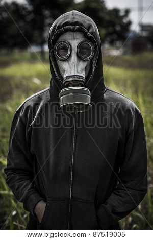 Human in hoodie and gas-mask