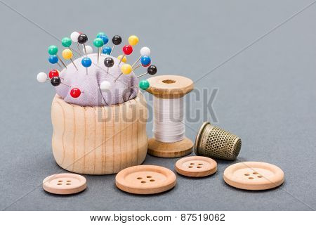 Thread, Buttons, Thimble And Pincushion