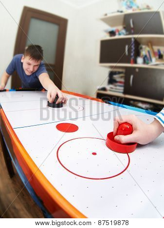 Children Playing On Air Hockey