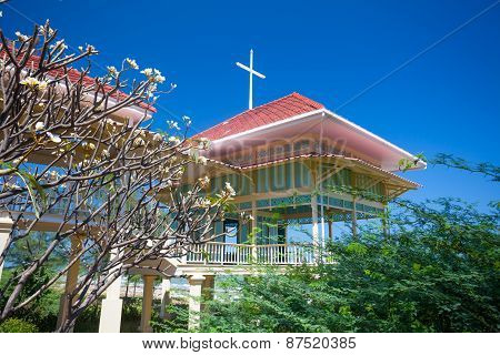 Pavilion And Corridor On Green Grass With Blue Sky