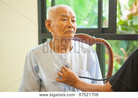 Friendly Doctor Caring Senior Man Indoor