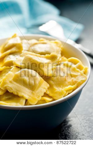 cooked ravioli in bowl on kitchen table