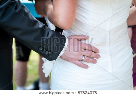 Man's hands hugging female booty, close-up
