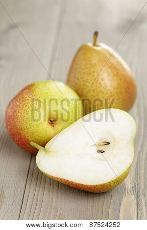 three ripe pears  on wood table