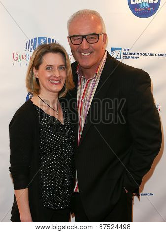 NEW YORK-MAR 28:Former heavyweight boxer Gerry Cooney (R)&Jennifer Cooney at the 2015 Garden Of Laughs Comedy Benefit at Club Bar and Grill at Madison Square Garden on March 28, 2015 in New York City.