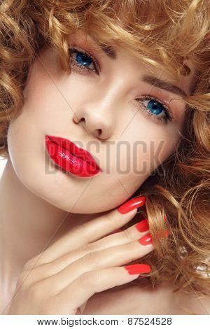 Close-up portrait of young beautiful woman with stylish manicure and red lipstick over white background