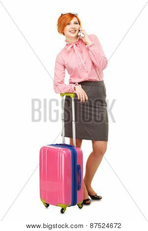 Business Woman In Business Trip With A Suitcase On Wheels Speaking Mobile  And Smiling