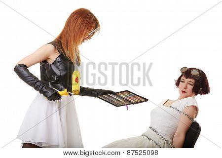 Crazy fashion concept. Visagist and blinked girl