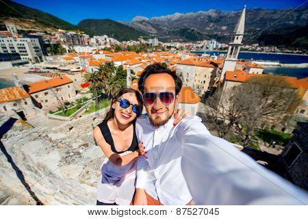 Couple taking self portrait in Budva