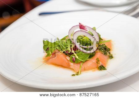 Arugula And Onion On Smoked Salmon