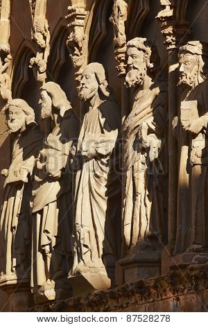Ancient Stone Sculptures In A Spanish Cathedral Portico. Olite, Navarra