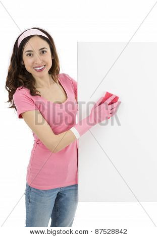 Cleaning Woman With A Cleaning Sponge Showing An Advertisement Billboard