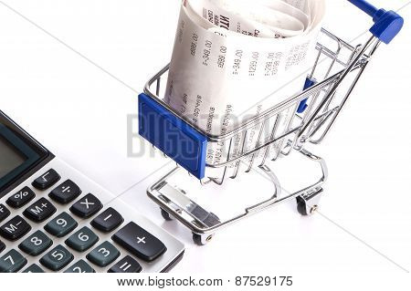Calculator And Shopping Trolley With Receipts