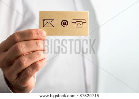 Hand Holding Small Paper With Contact Icons