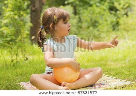 Little girl pointing finger at something