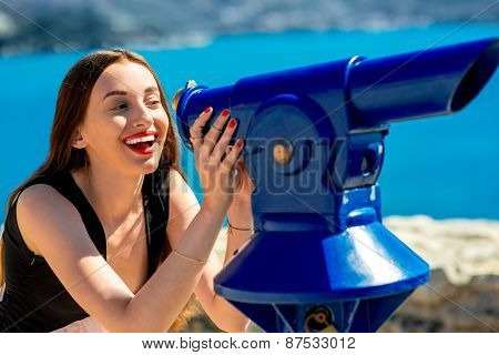 Woman looking with telescope