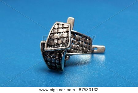 Large Silver Ring On A Blue Background