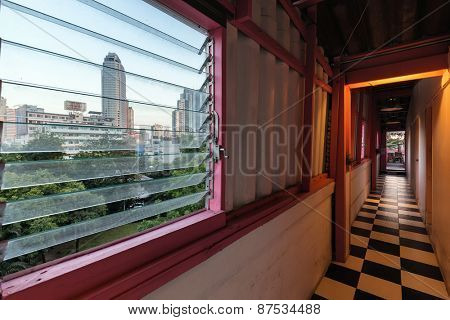 BANGKOK, THAILAND, DECEMBER 25, 2014: View from inside a guesthouse hallway over the window in the Thong Lor district in Bangkok, Thailand.